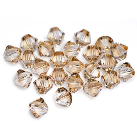 Bicono Punta Swarovski Golden Shadow 4mm (6 Unidades)